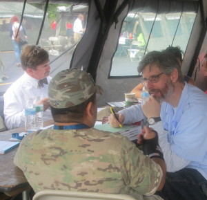 Dan Nagin, Director of the Veterans Legal Clinic at LSC, meets with a veteran at Stand Down 2014